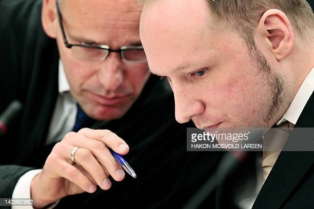 Rightwing extremist Anders Behring Breivik who killed 77 people in twin attacks in Norway last year confers with his lawyer Geir Lippestad at the...