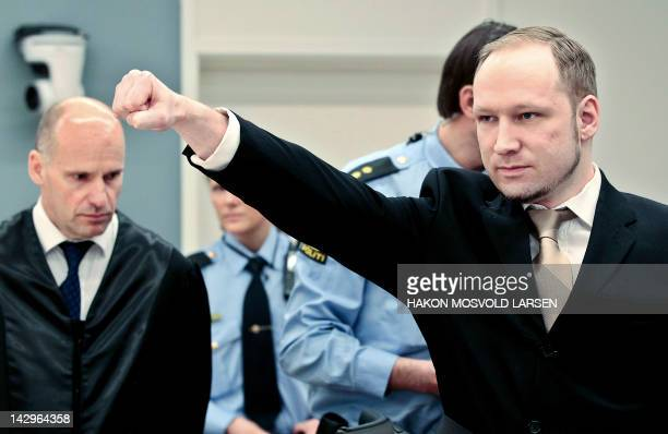 Rightwing extremist Anders Behring Breivik who killed 77 people in twin attacks in Norway last year makes a farright salute as he enters with his...