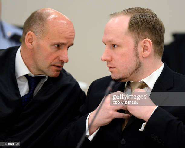 Rightwing extremist Anders Behring Breivik who killed 77 people in twin attacks in Norway last year speaks with his lawyer Geir Lippestad at the...