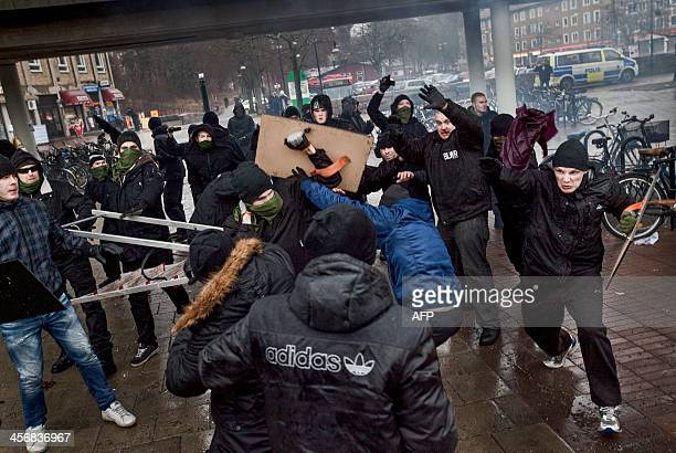Rightwing extremists attack an antinazi demonstration in the Stockholm suburb Karrtorp Sweden on December 15 2013 One policeman and two others were...