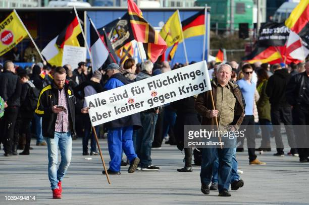 Rightwing extremists gather for a demonstration under the slogan 'Merkel muss weg' in Berlin Germany 04 March 2017 Photo Maurizio Gambarini/dpa |...