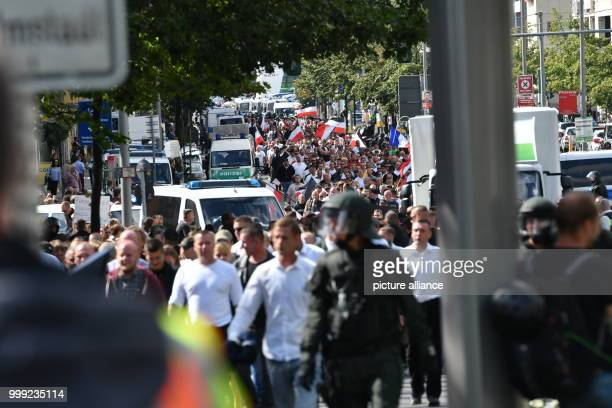 Rightwing extremists walk across the street to commemorate the 30th anniversary of the death of Hitler's deputy Rudolf Hess at the Spandau train...