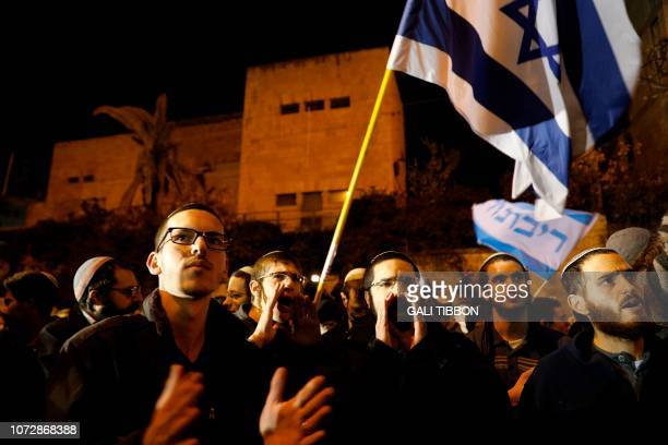 Rightwing Israelis mostly from settlements in the occupied West Bank protest outside the residence of Prime Minister Benjamin Netanyahu in Jerusalem...