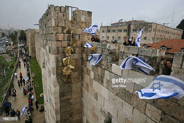 Rightwing Israelis protest against negotiations on the 'core issue' of the status of Jerusalem on January 8 2008 on the walls of Jerusalems old city...