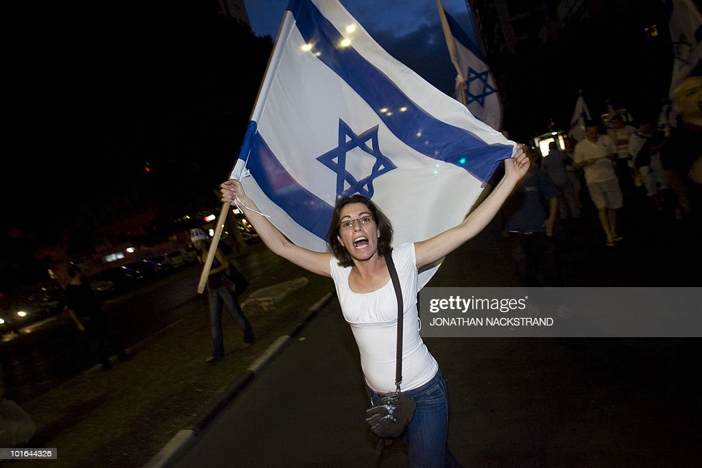 Right-wing Israelis waving national flags demonstrate against thousands of Arabs and left-wing Jewish peace activists who were protesting in Tel Aviv on June 5, 2010 against the occupation of Palestinian territories, marking the 43rd anniversary of their conquest in the 1967 Six-Day War.