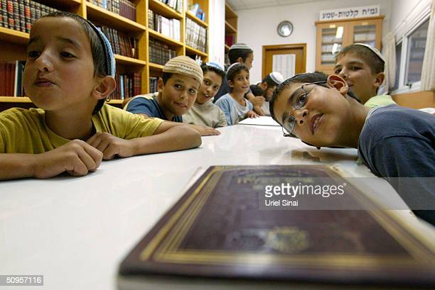 Rightwing Jewish settler children participate in a Torah lesson as their parents attend to a general meeting called to prepare a plan of action...