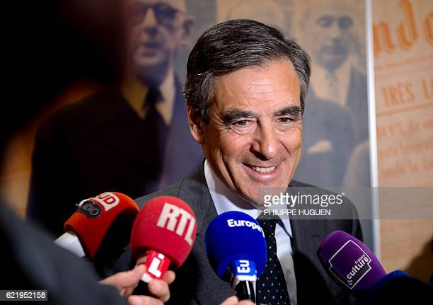 Rightwing Les Republicains party's candidate for the party's primary ahead of the 2017 presidential election Francois Fillon speaks to journalists...