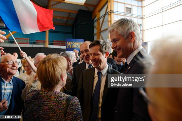 Right-wing Les Républicains party president Laurent Wauquiez and leading candidate François-Xavier Bellamy attend a campaign meeting for the upcoming...