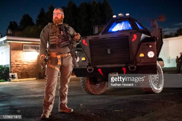 Right-wing militia member guards a business with an armored vehicle during a vigil for Kevin E. Peterson Jr., on October 30, 2020 in Vancouver,...