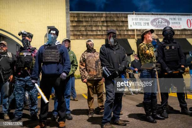 Right-wing militia members guard a business during a vigil for Kevin E. Peterson Jr., on October 30, 2020 in Vancouver, Washington. Clark County...