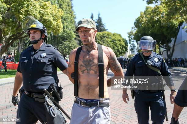 A rightwing NoToMarxism rally attendee is arrested on August 27 2017 at Martin Luther King Park Jr Park in Berkeley California / AFP PHOTO / Amy...