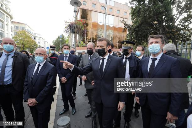 Right-wing party Les Republicains MP Eric Ciotti, French President Emmanuel Macron and Nice Mayor Christian Estrosi visit the scene of a knife attack...