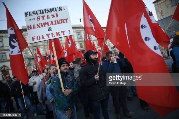 Right-wing protesters march carrying satirical banners, flags and signs in mock-support of German Chancellor Angela Merkel on the day she visited the...