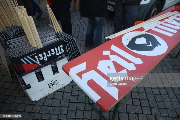 """Right-wing protesters set up a table with a banner that reads: """"Heil Merkel"""" in mock-support of German Chancellor Angela Merkel on the day she..."""