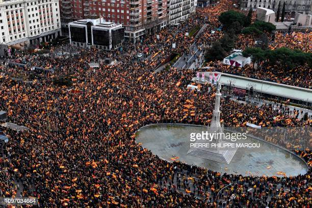 Rightwing protesters wave Spanish flags during a demonstration at Plaza de Colon in Madrid against Spanish Prime Minister Pedro Sanchez on February...