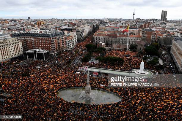 Rightwing protesters wave Spanish flags during a demonstration in Madrid against Spanish Prime Minister Pedro Sanchez on February 10 2019 The...