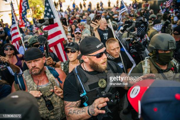 Right-wing protestor speaks with left-wing protestors in front of the Louisville Metro Hall on September 5, 2020 in Louisville, Kentucky. Ahead of...