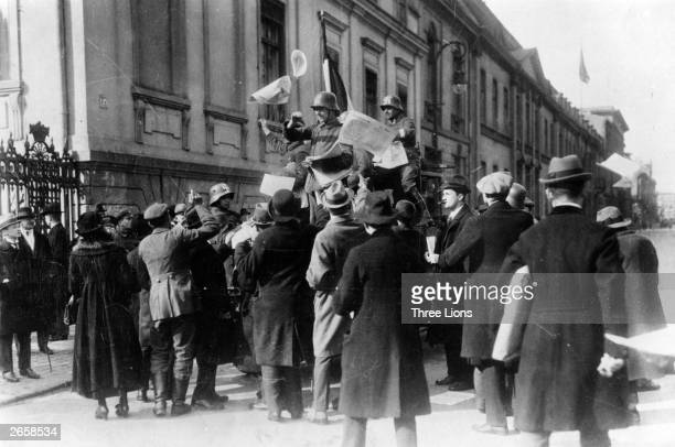 Rightwing revolutionists with swastikas painted on their helmets distribute leaflets during the Kapp revolution in Munich The revolt was suppressed...