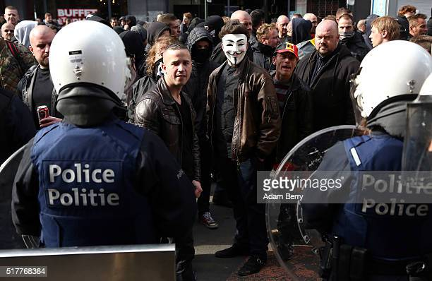 Right-wing self-described hooligans hold a demonstration on Place de la Bourse on March 27 in Brussels, Belgium. Days after suicide bomber attacks at...