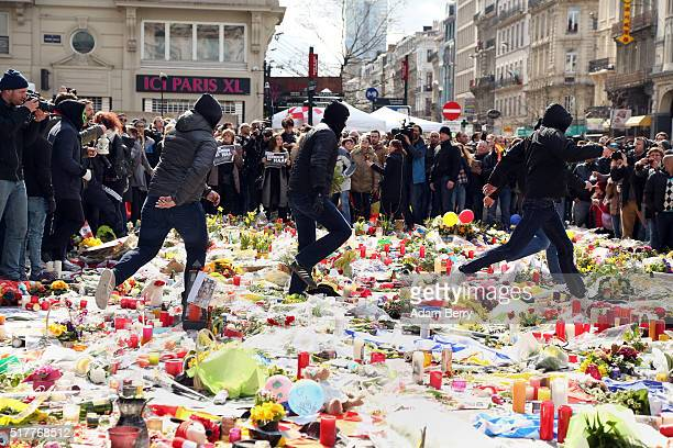 Right-wing self-described hooligans trample over flowers and candles left over the previous few days at Place de la Bourse for victims of...