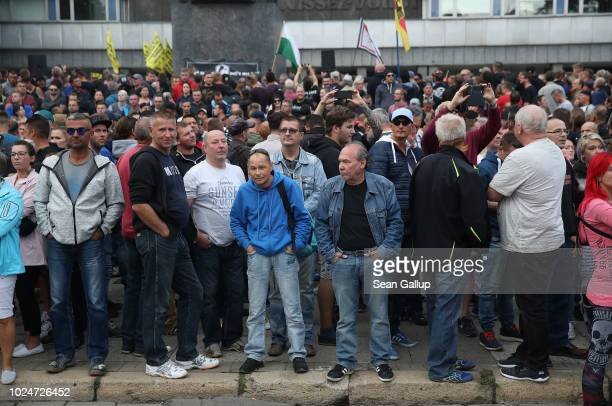 Right-wing supporters attend a protest gathering the day after a man was stabbed and died of his injuries on August 27, 2018 in Chemnitz, Germany. A...