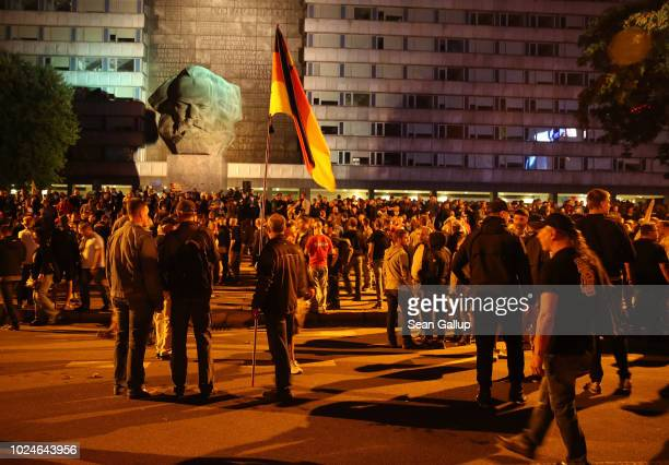 Rightwing supporters conclude a protest match near a monument to Karl Marx the day after a man was stabbed and died of his injuries on August 27 2018...