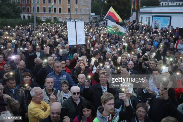 Rightwing supporters gather otside CFC stadium to protest against Saxony Governor Michael Kretschmer who was holding a dialogue with locals inside on...