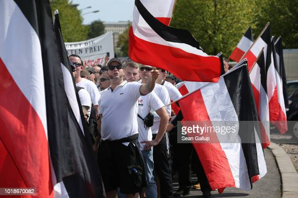 Rightwing supporters gather to march with flags in the colors of the former German Empire to commemorate the anniversary of the death of Rudolf Hess...