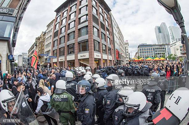 Rightwing supporters participate in a demonstration organized by the neoNazi 'Widerstand OstWest' group on June 20 2015 in Frankfurt Germany An...