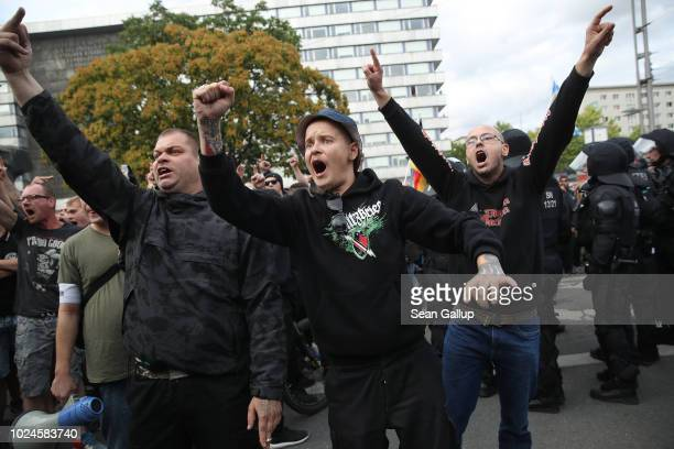 Right-wing supporters shout abuse at nearby heckling leftists at a right-wing protest gathering the day after a man was stabbed and died of his...