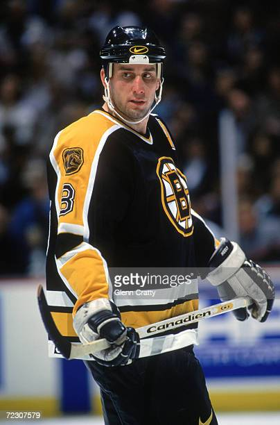 Rightwinger Cam Neely of the Boston Bruins looks on during a game against the Anaheim Mighty Ducks at Arrowhead Pond on February 21 1996 in Anaheim...