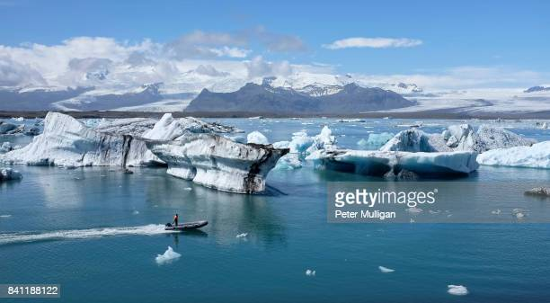 A rigid inflatable boat powers across the glacier lagoon at Jokulsarlon, Iceland