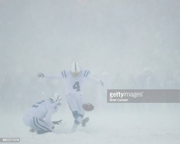 Rigoberto Sanchez holds as Adam Vinatieri of the Indianapolis Colts attempts and misses a field goal during the first quarter against the Buffalo...
