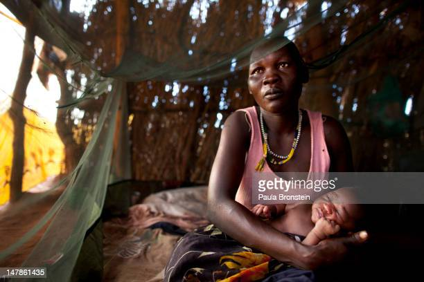 Rihab Kisa holds her newborn baby girl Jajia born overnight inside her small hut at the Yida refugee camp along the border with North Sudan July 5...