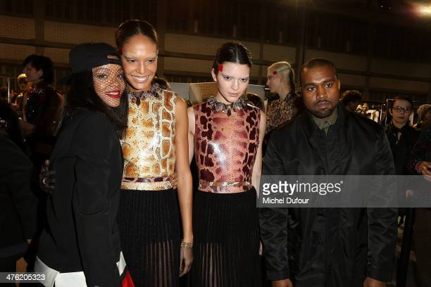 Rihanna a model Kendall Jenner and Kanye West pose after the Givenchy show as part of the Paris Fashion Week Womenswear Fall/Winter 20142015 on March...