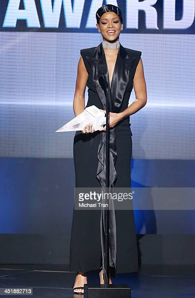 Rihanna accepts the AMA Icon Award onstage at the 2013 American Music Awards held at Nokia Theatre LA Live on November 24 2013 in Los Angeles...