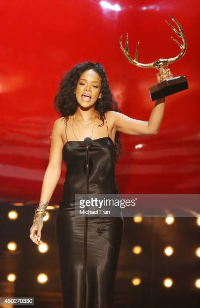 Rihanna accepts the Most Desirable Woman award onstage during Spike TV's 'Guys Choice' Awards held at Sony Studios on June 7 2014 in Los Angeles...
