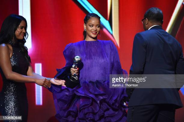 Rihanna accepts the President's Award from NAACP President and CEO Derrick Johnson onstage during the 51st NAACP Image Awards Presented by BET at...