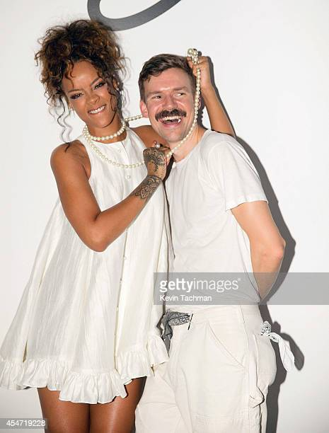 Rihanna and Adam Selman pose for a photo after Adam Selman's presentation during MercedesBenz Fashion Week Spring 2015 at Algus Greenspon Gallery on...