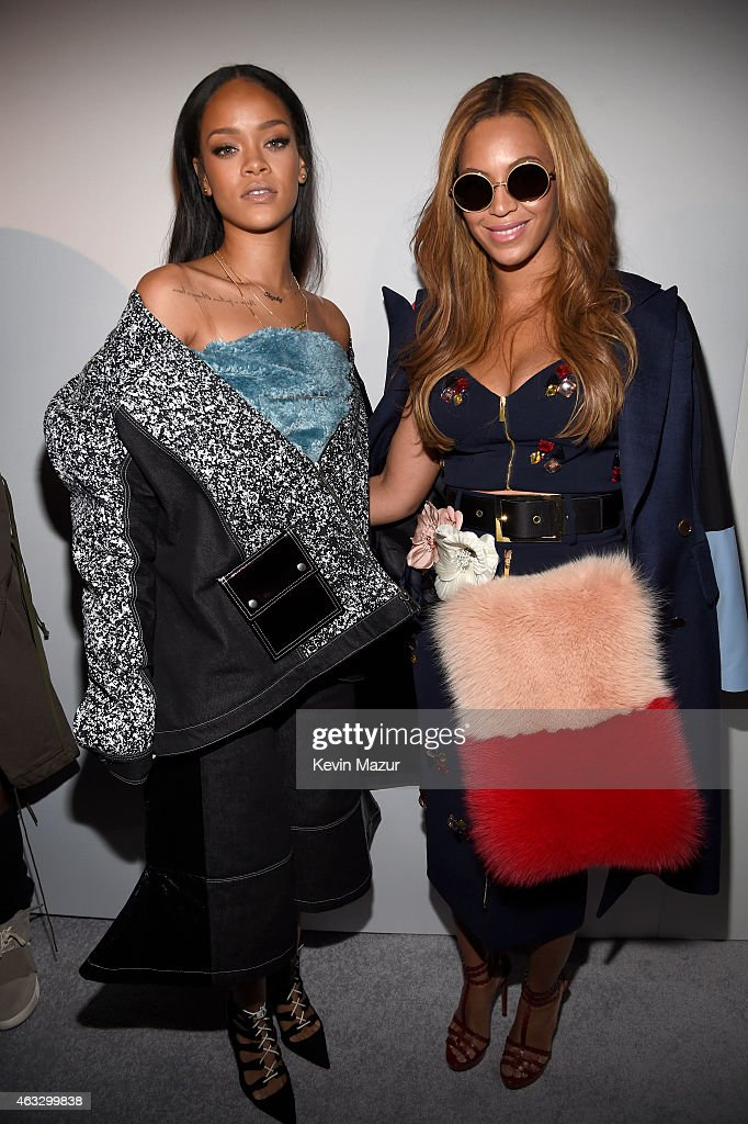 Rihanna (L) and Beyonce pose backstage at the adidas Originals x Kanye West YEEZY SEASON 1 fashion show during New York Fashion Week Fall 2015 at Skylight Clarkson Sq on February 12, 2015 in New York City.