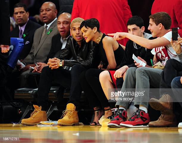 Rihanna and Chris Brown attend a game between the New York Knicks and the Los Angeles Lakers during the NBA game at Staples Center in Los Angeles...