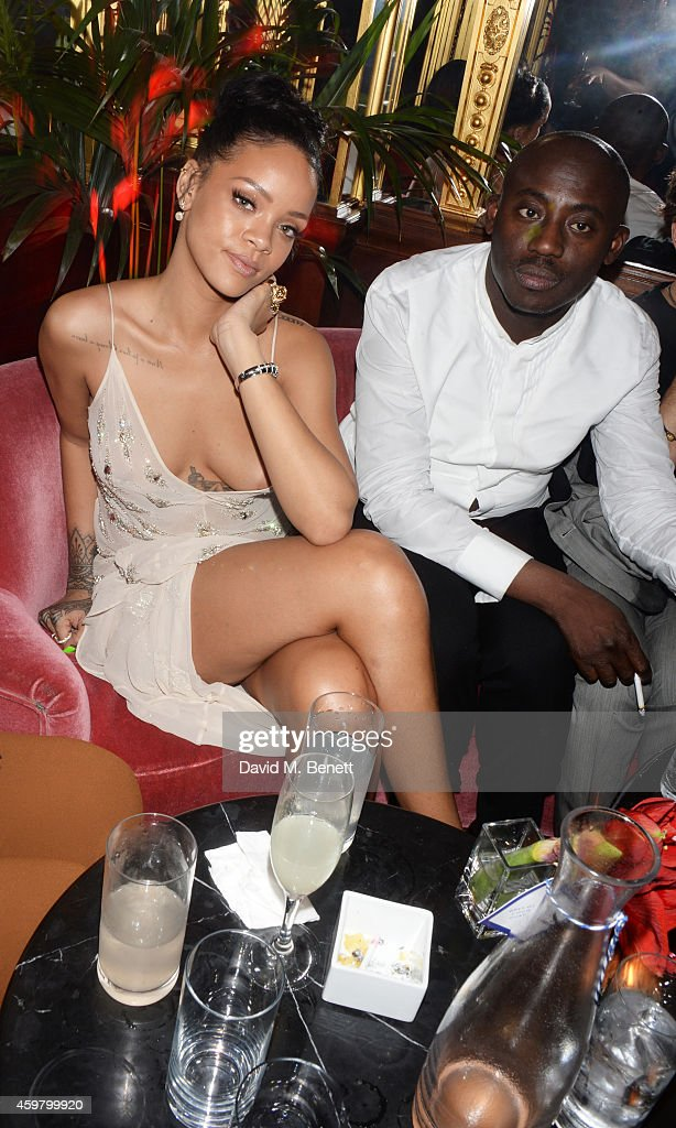 Rihanna (L) and Edward Enninful attend a party in celebration of Edward Enninful in The Oscar Wilde Bar, Hotel Cafe Royal, on December 1, 2014 in London, England.