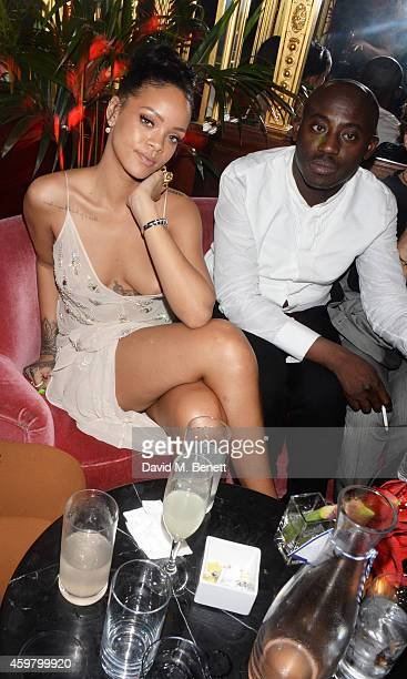 Rihanna and Edward Enninful attend a party in celebration of Edward Enninful in The Oscar Wilde Bar Hotel Cafe Royal on December 1 2014 in London...