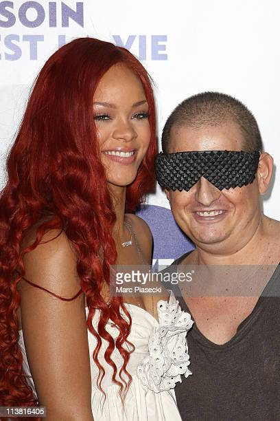 Rihanna and fan attend the 'Nivea And Rihanna Celebrating 100 Years Of Skincare' photocall at Grand Hotel Intercontinental on May 6 2011 in Paris...