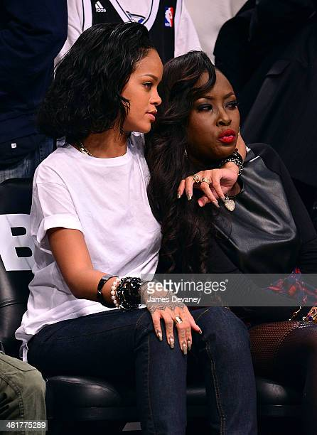 Rihanna and guest attend the Miami Heat vs Brooklyn Nets game at Barclays Center on January 10 2014 in the Brooklyn borough of New York City