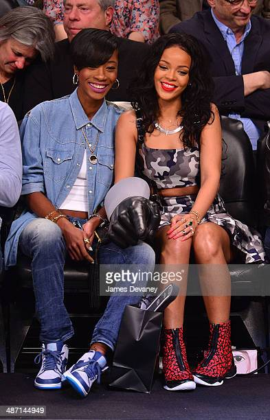 Rihanna and guest attend the Toronto Raptors vs Brooklyn Nets playoff game at Barclays Center on April 27 2014 in New York City