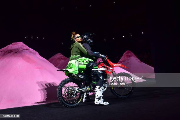 Rihanna and Matt Buyten on the runway at the Fenty Puma By Rihanna fashion show during New York fashion week at Park Avenue Armory on September 10...
