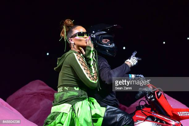 Rihanna and Matt Buyten on the runway at the Fenty Puma By Rihanna fashion show during New York fashion week at Park Avenue Armory on September 10...