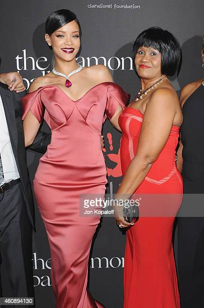 Rihanna and mom Monica arrive at Rihanna's First Annual Diamond Ball at The Vineyard on December 11 2014 in Beverly Hills California
