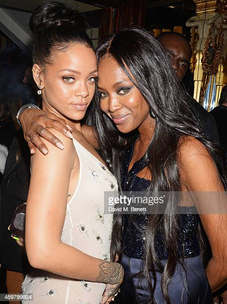 Rihanna and Naomi Campbell attend a party in celebration of Edward Enninful in The Oscar Wilde Bar Hotel Cafe Royal on December 1 2014 in London...